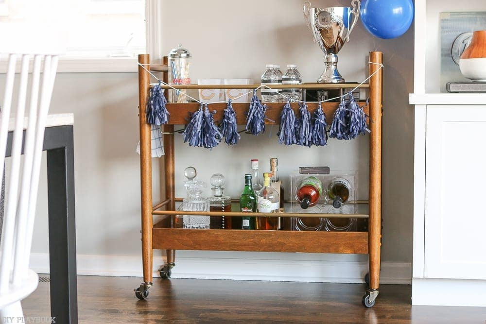 Here's our bar cart, all stocked and decorated with our team's colors for the big game!
