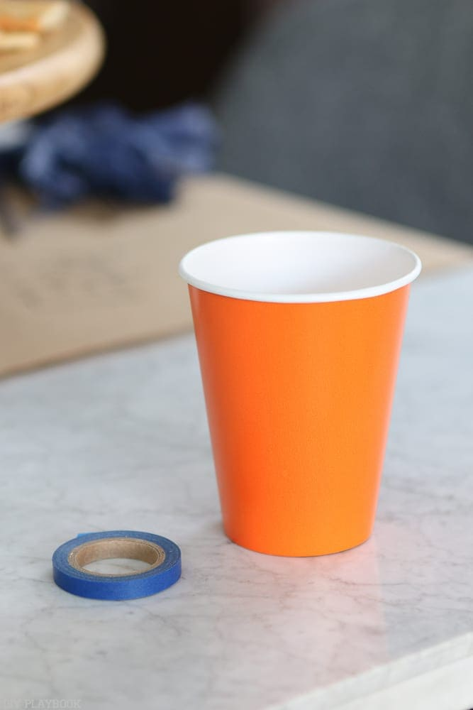 Start with an orange cup and some washi tape.