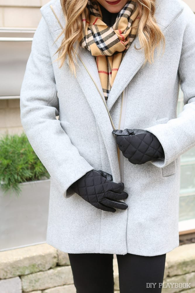 This classic wool coat pairs well with a patched winter scarf.