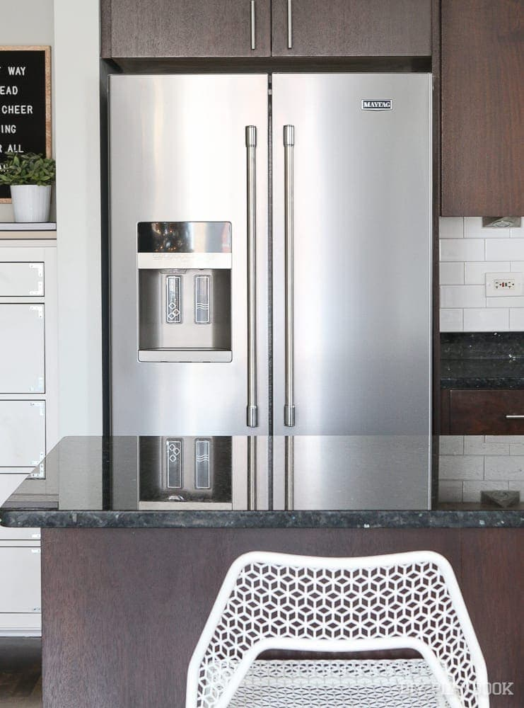 I love our new kitchen appliances from Maytag, like this stainless steel fridge with parlor doors!