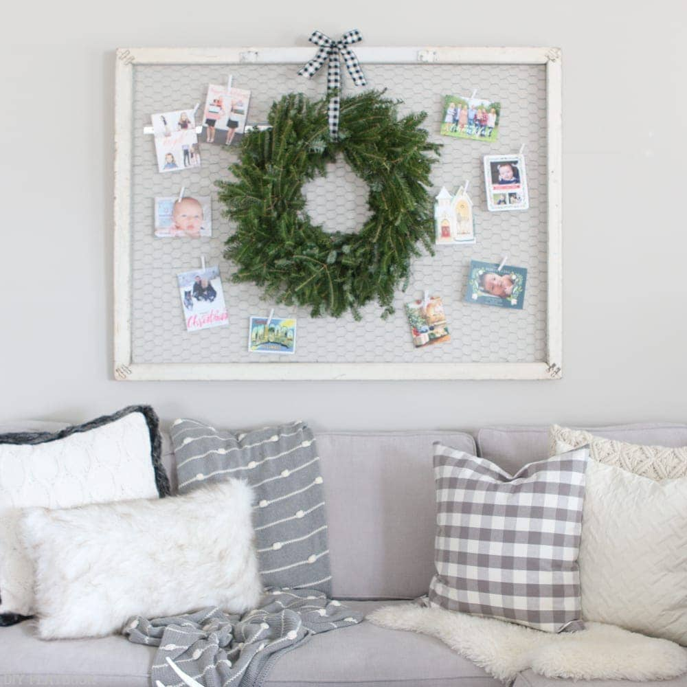 A christmas card display over a couch