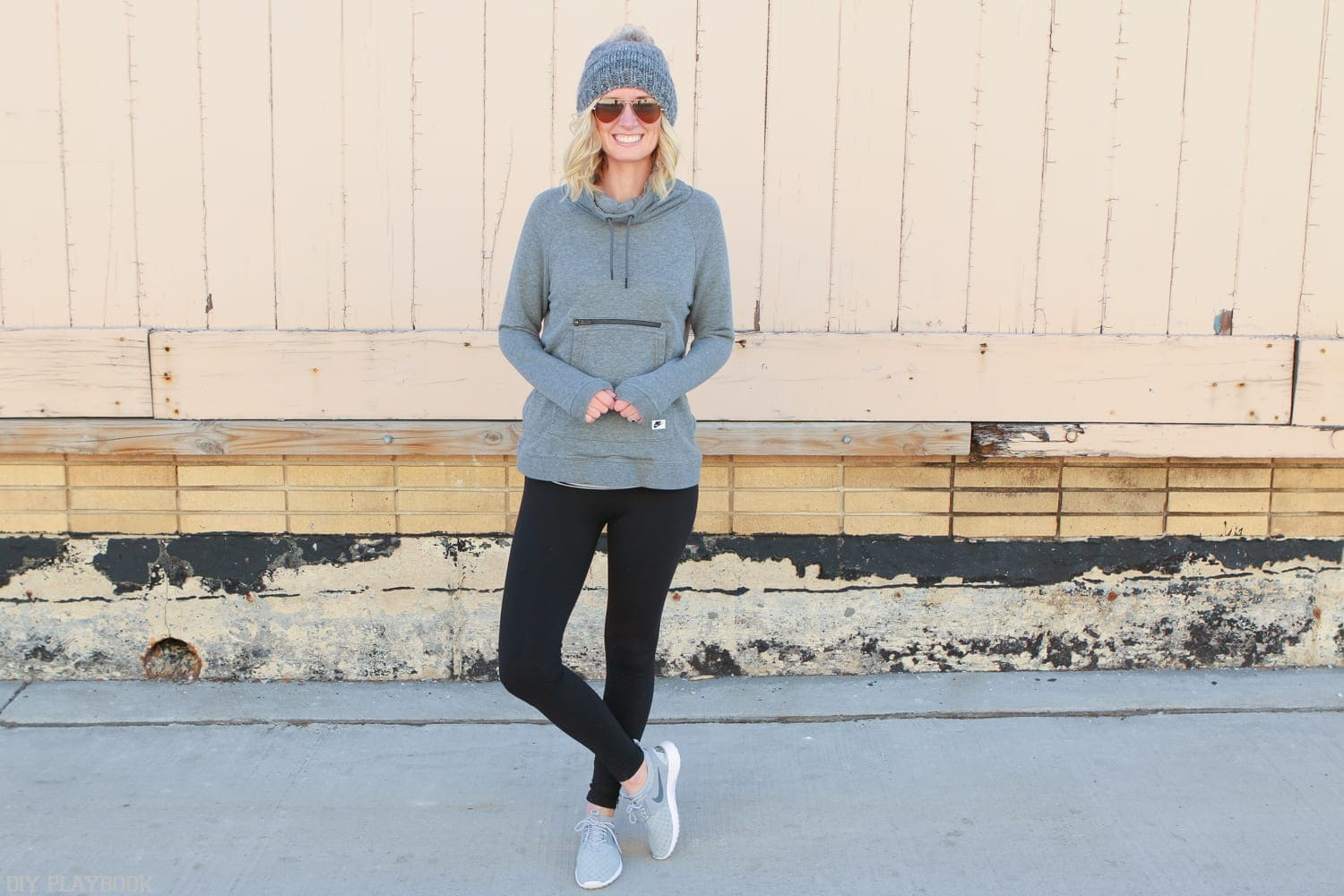 Bridget looks great in her Athleisure Pieces to Wear Anytime, inlcuding her new grey cowl neck sweatshirt and black leggings with side zippers.