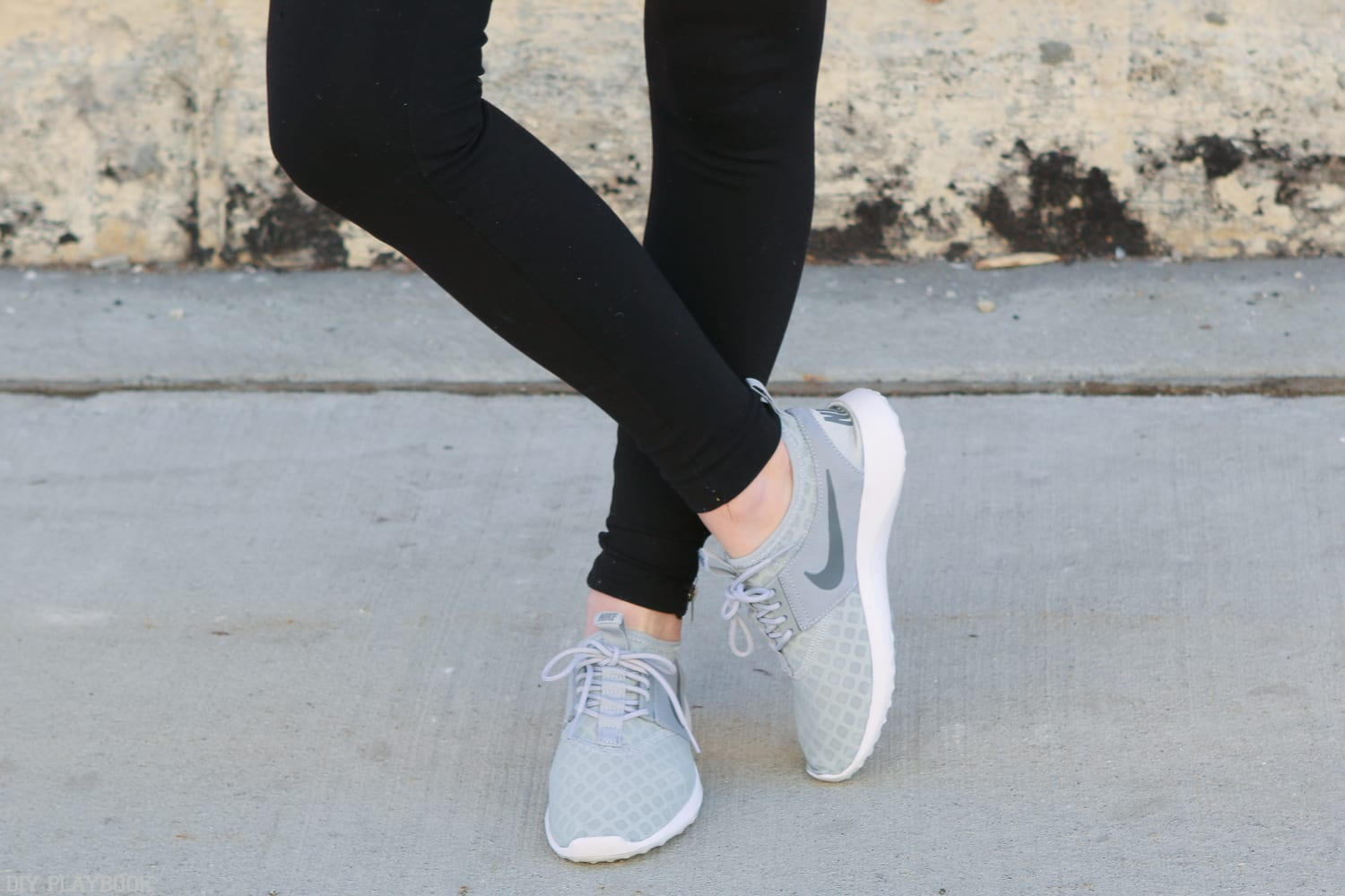 Time for a jog! These grey Nike sneakers work for working out or runnin errands.