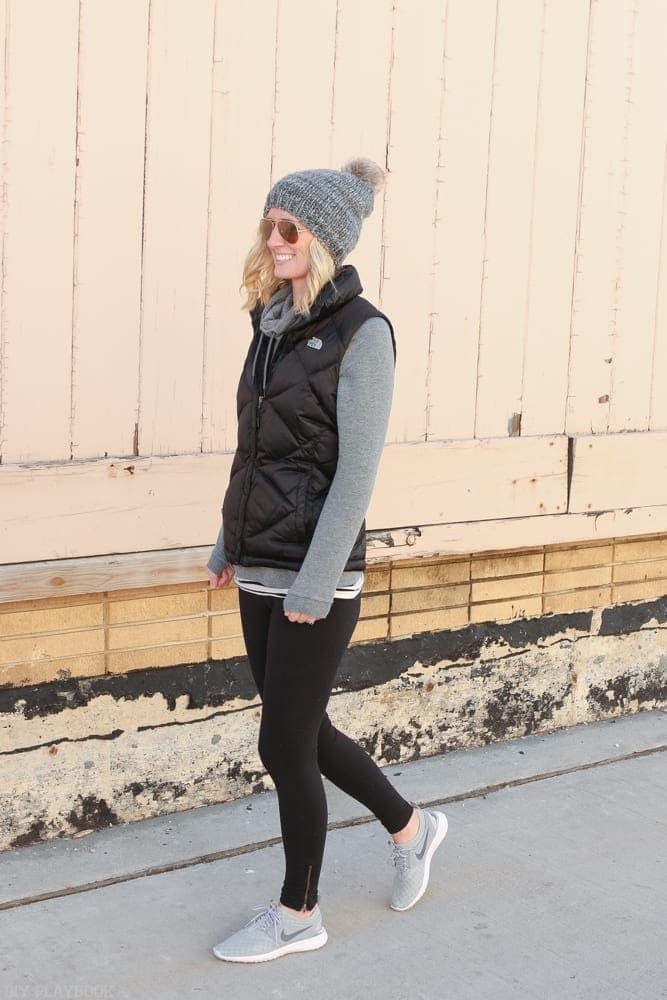 Bridget's favorite Athleisure Pieces to Wear Anytime inlcude grey sneakers, black leggings and a grey pull over hoodie