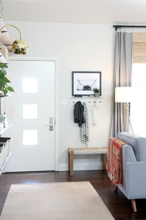 A bench near the front door adds decor to the entryway.
