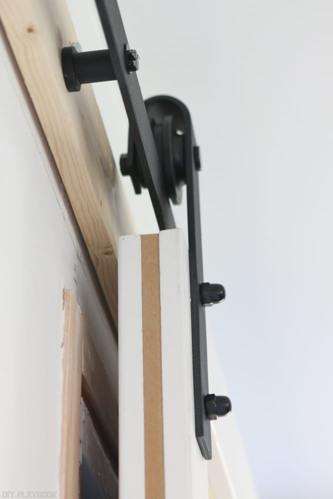 How to hang the door on the track, from below