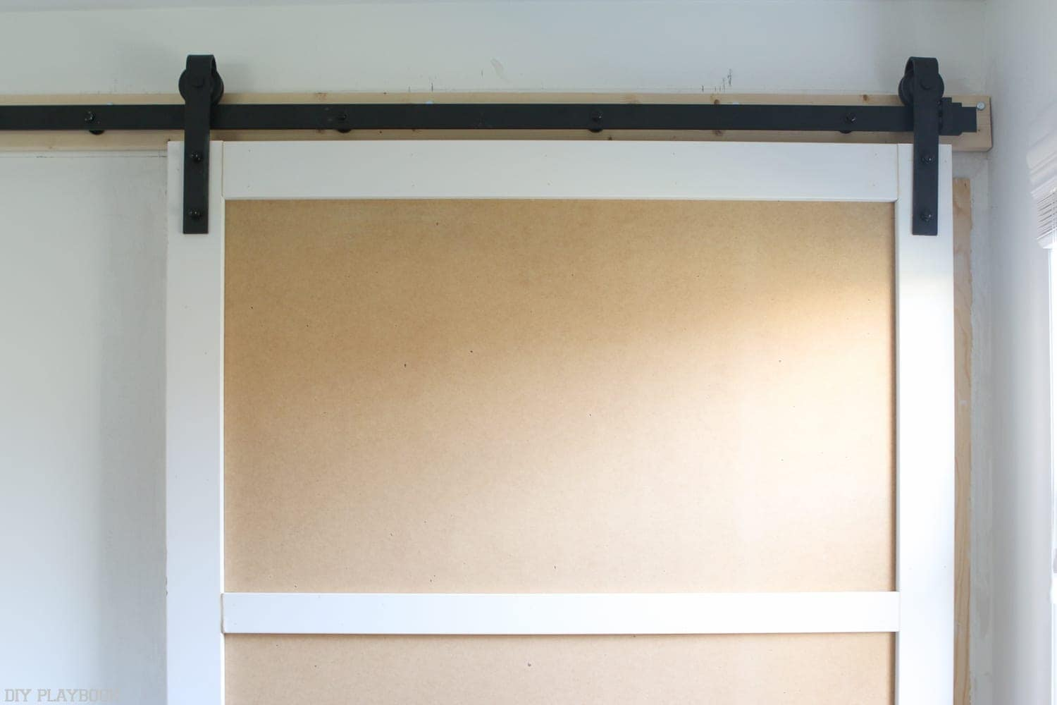 how to build a barn door track