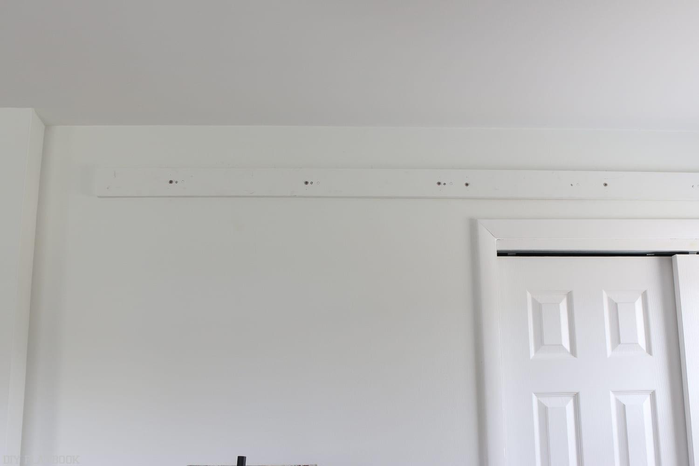 Hanging a DIY Barn Door Step One: Hanging the Track | DIY