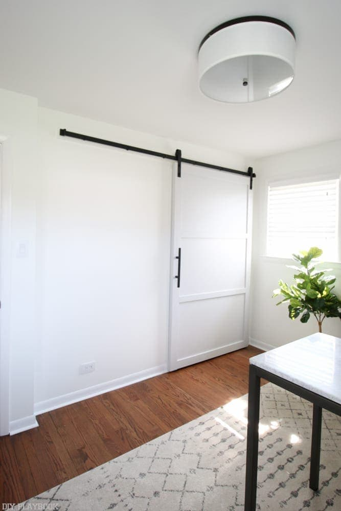 Adjust the rails: How to Hang a Barn Door in your Home DIY | DIY Playbook