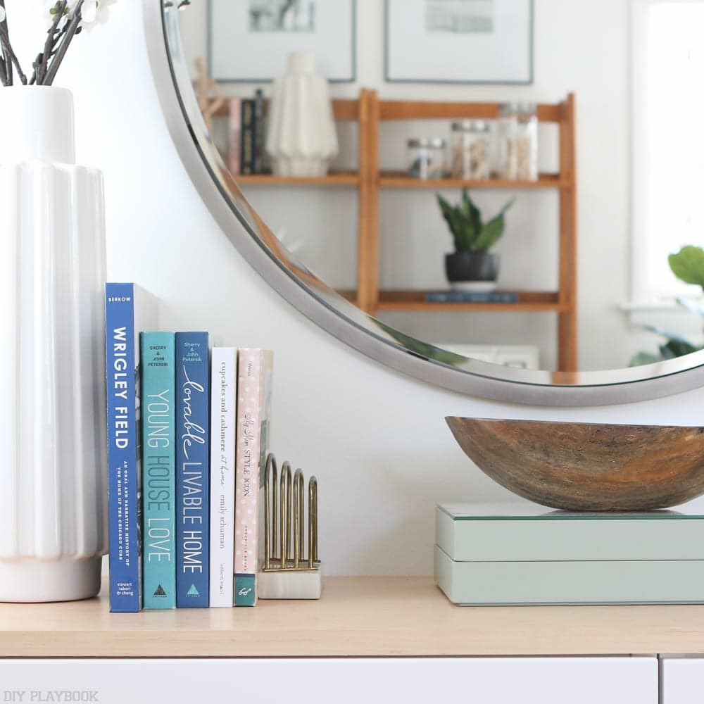 Fauxdenza mirror, books, and spring office accessories.