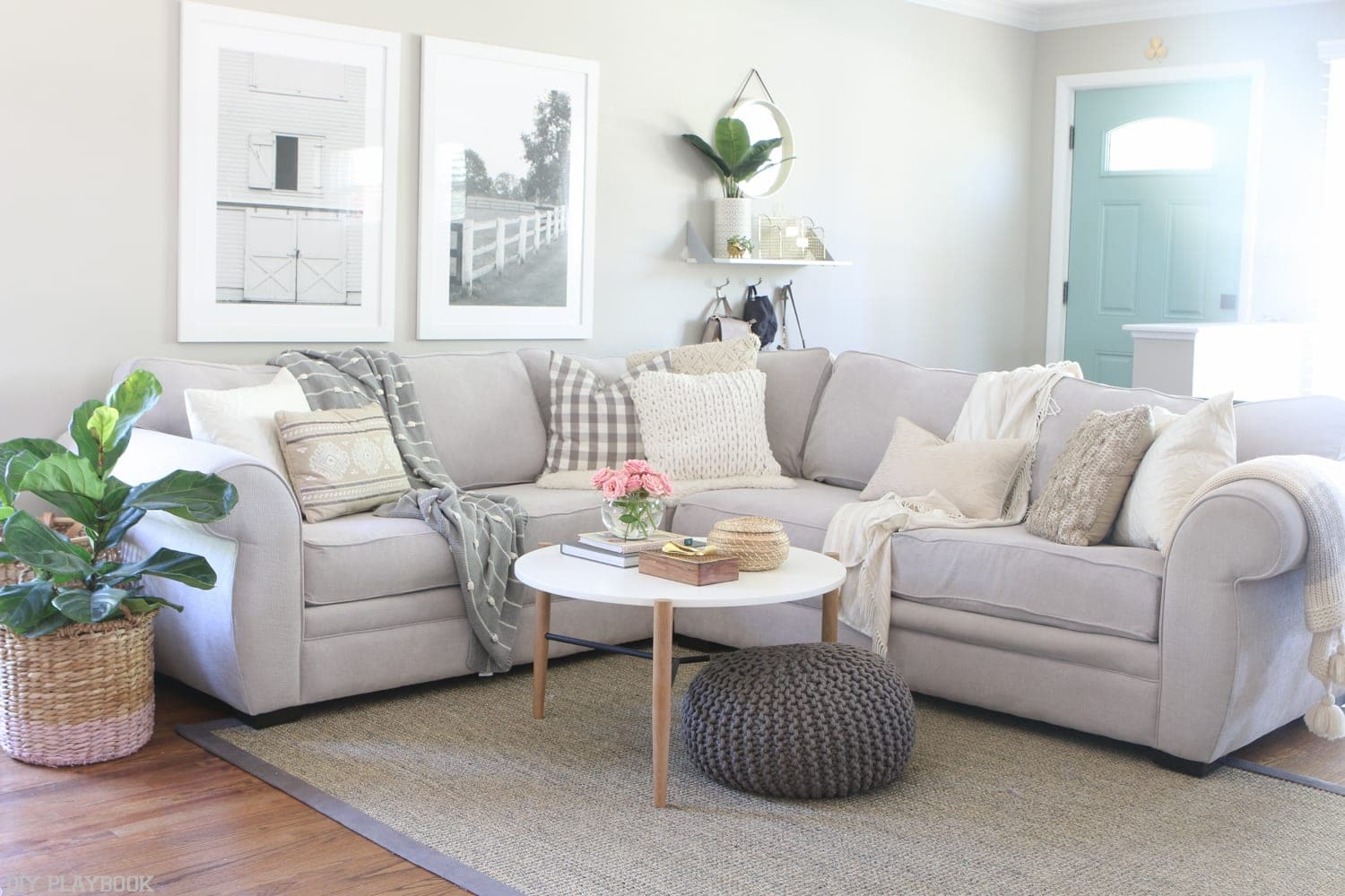 A gray sectional from Macy's warms up this neutral living room space.