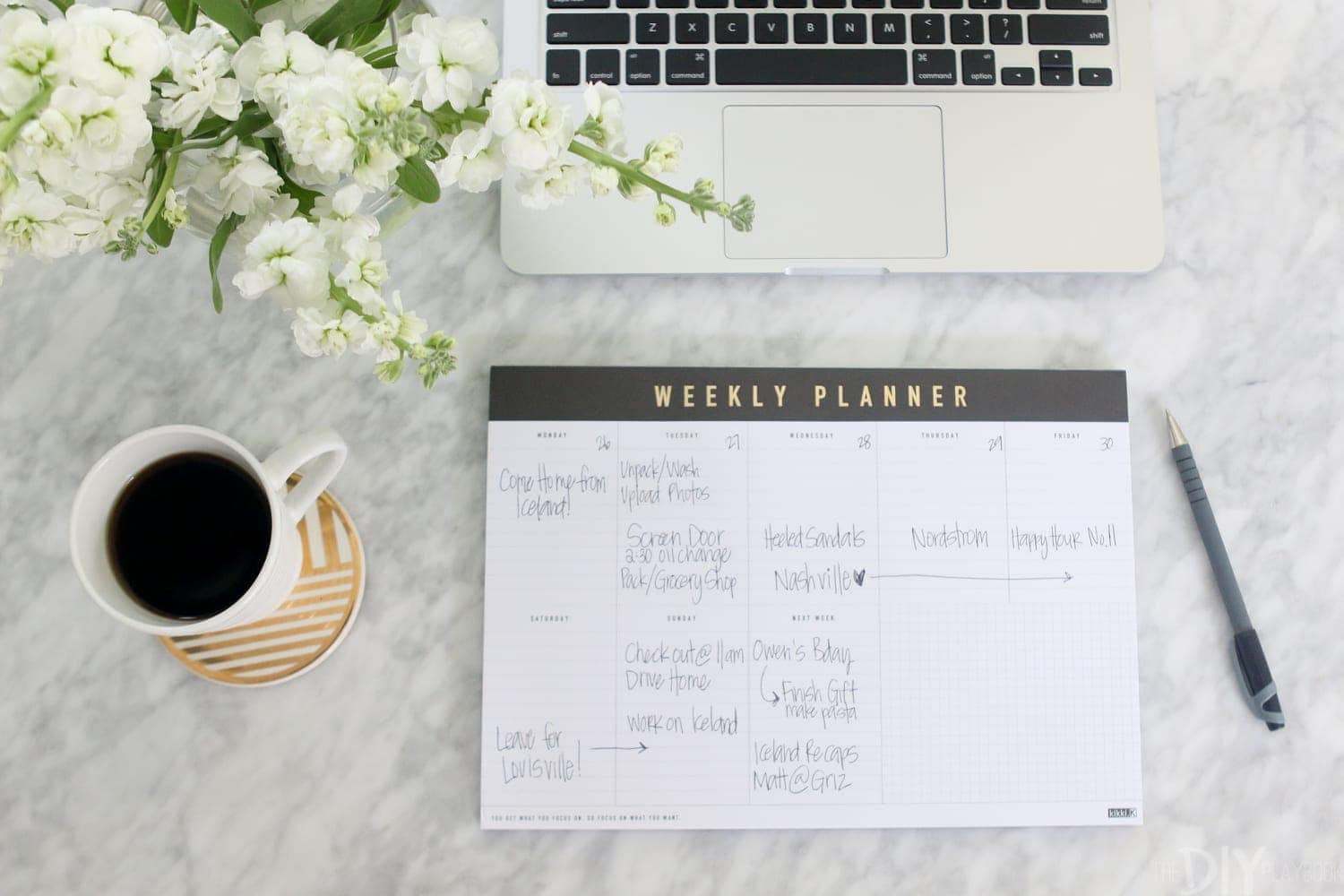Love these white flowers and this weekly planner! Added both to my office space.