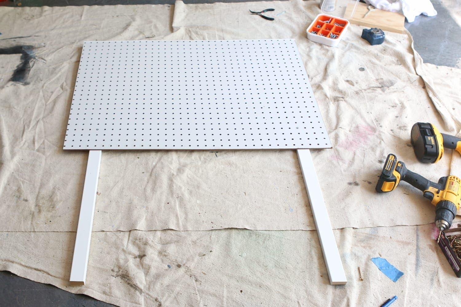 Prepare the pegboard: DIY Kid's Tool Bench: Step by Step Tutorial | DIY Playbook