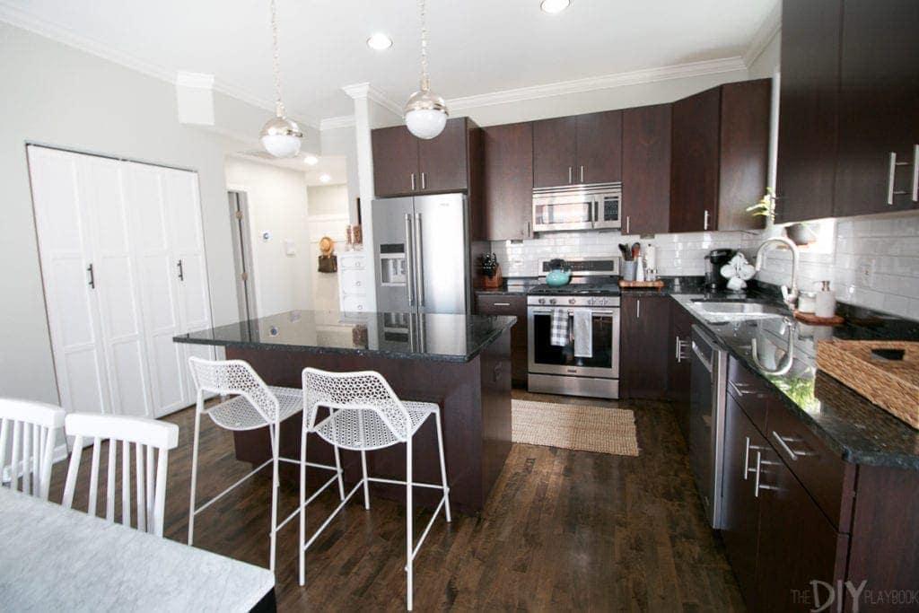 White mesh stools in a dark kitchen