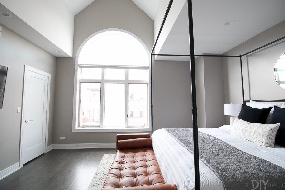 This large window lets so much natural light into this room, so gray is a perfect color for this modern bedroom design.