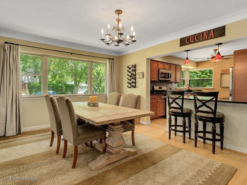Make sure you measure all the rooms - like this open dining room and kitchen - so you can start shopping for furnitre and rugs before you move in.