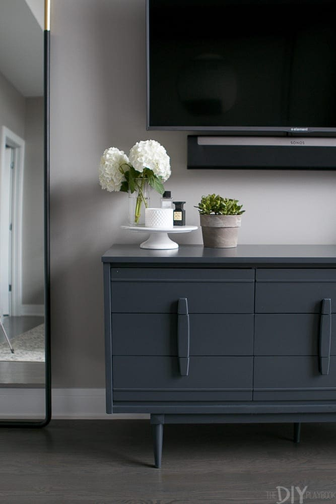 The gray dresser is full of storage space.