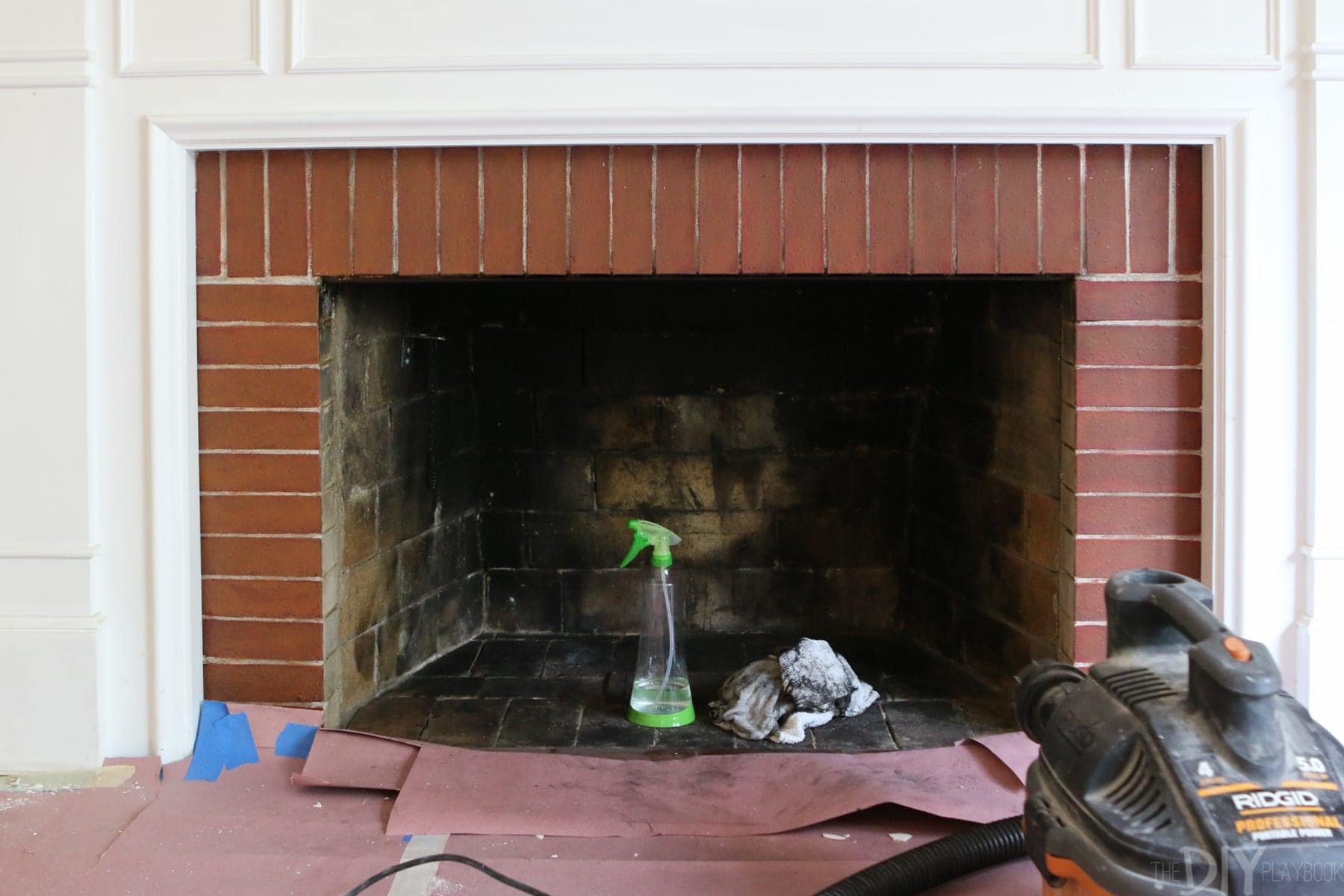 cleaning out the inside of a fireplace