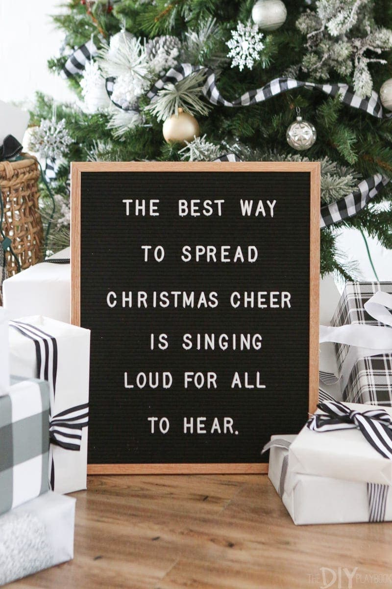 "We love this black and white Christmas sign! ""The Best Way To Spread Christmas CHeer Is Singing Loud For All To Hear."""