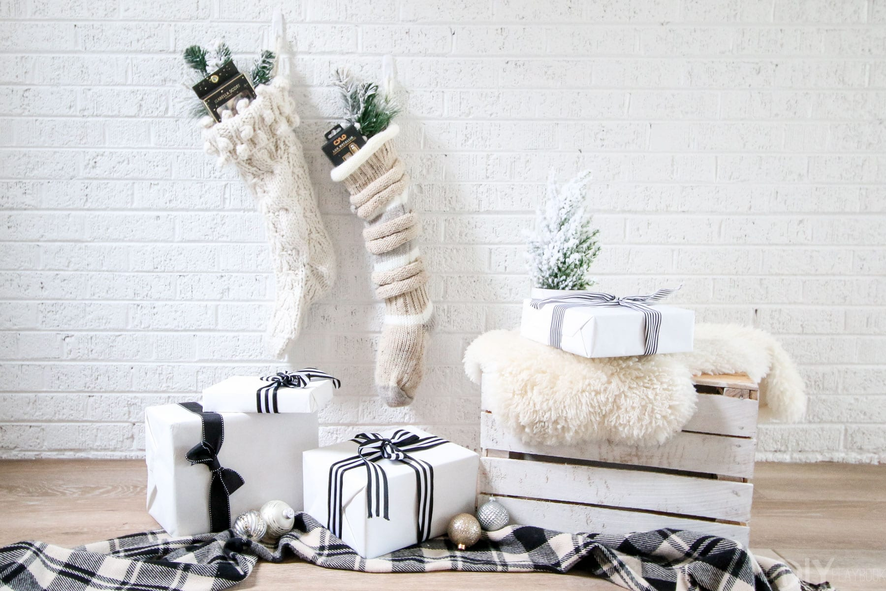 This christmas scene has all the essentials; stocking stuffers, presents, and a warm winter blanket.
