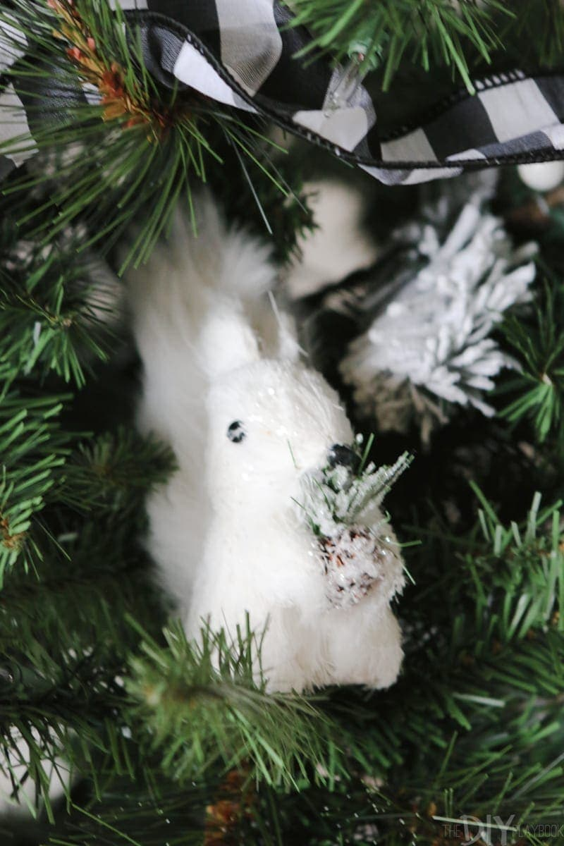 How amazing is this litle white squirrel? He's hiding in the branches of our black and white Christmas Tree.
