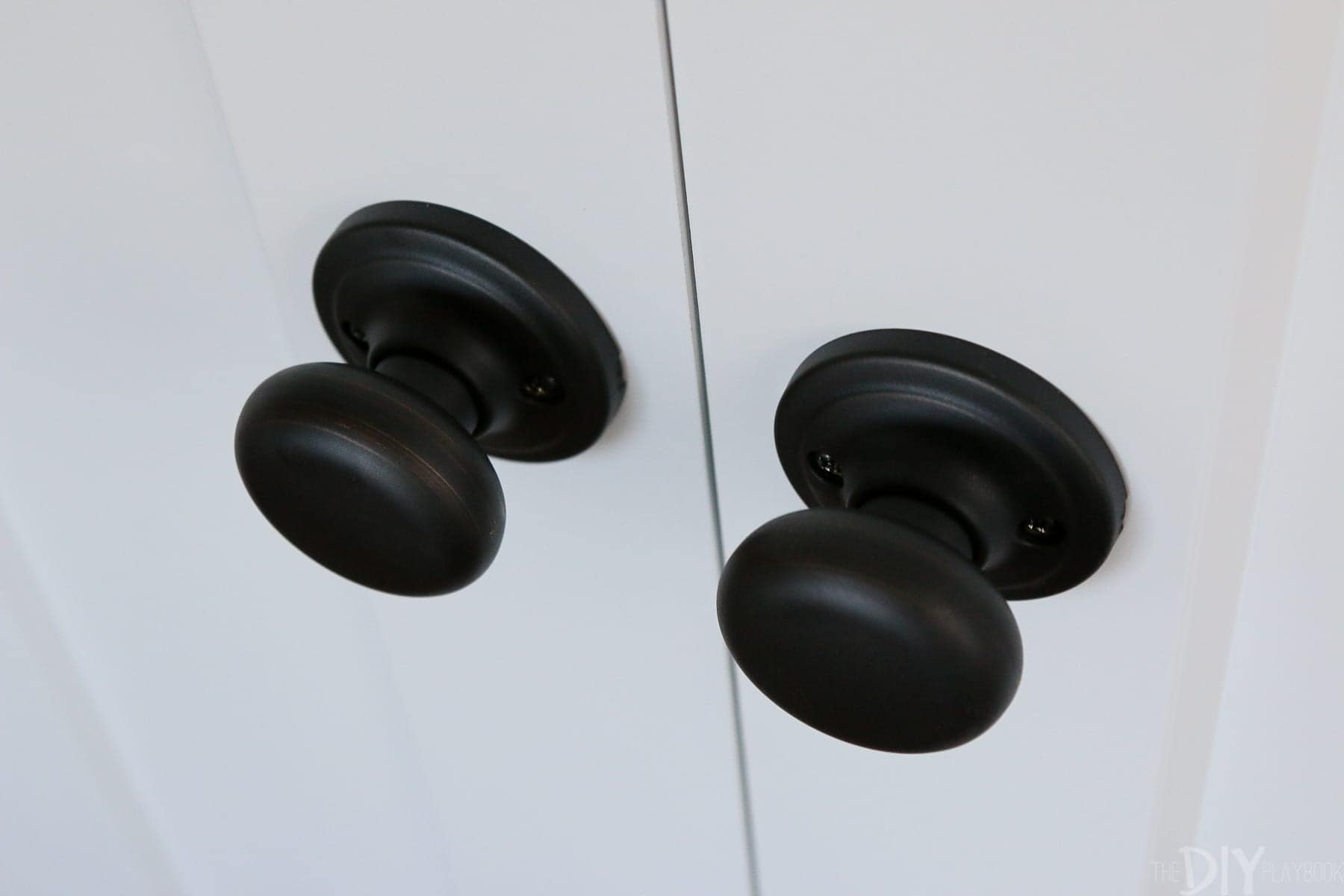 The hardware on the dummy doors matches the rest of the doors.