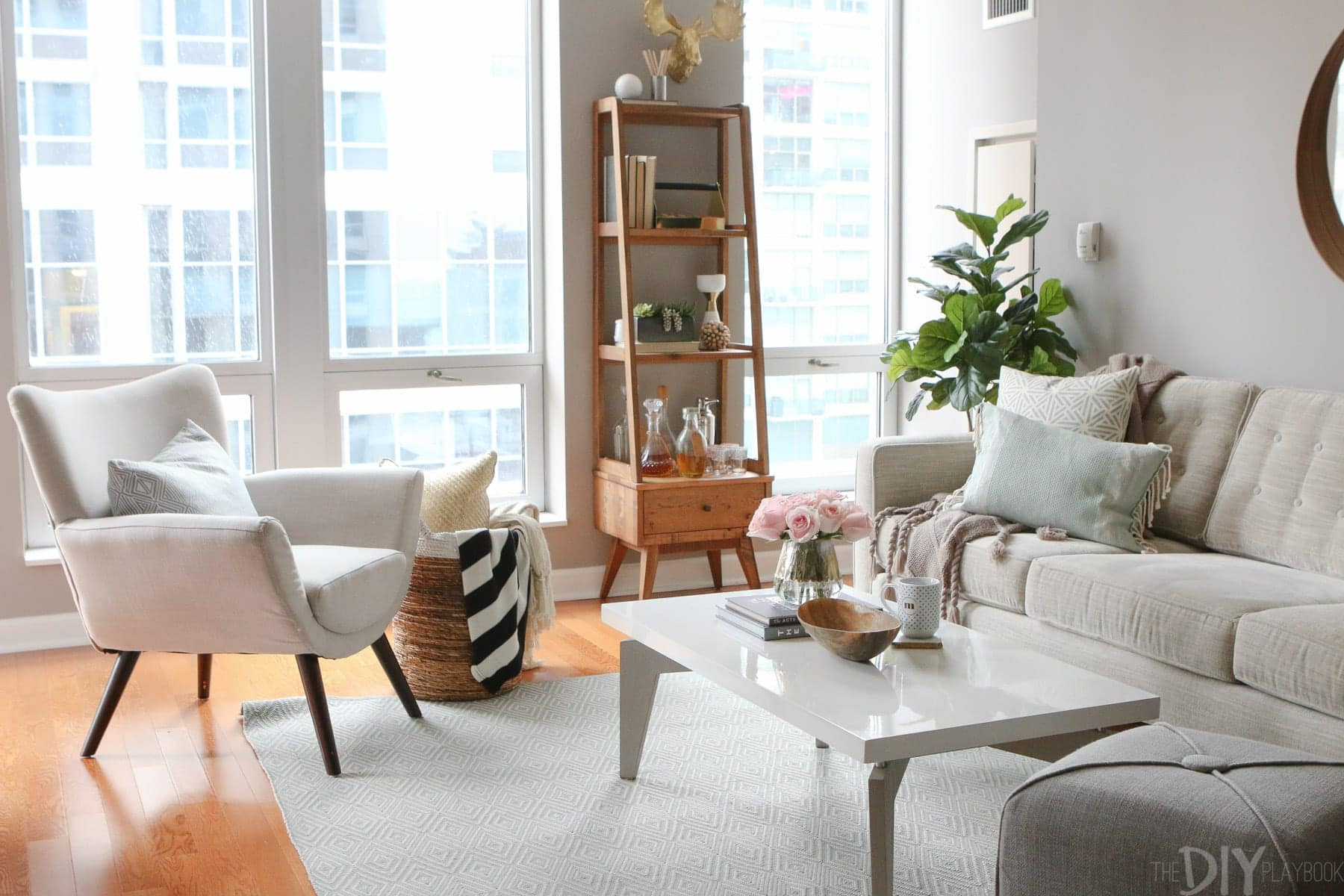 We styled the living room in our friend Maggie's condo. Here's how her designs turned out.