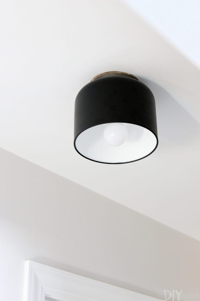 Add a semi-flush mount light fixture to the ceiling