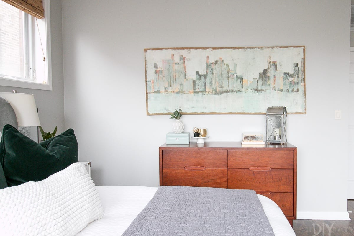 Skyline art over a bedroom dresser.