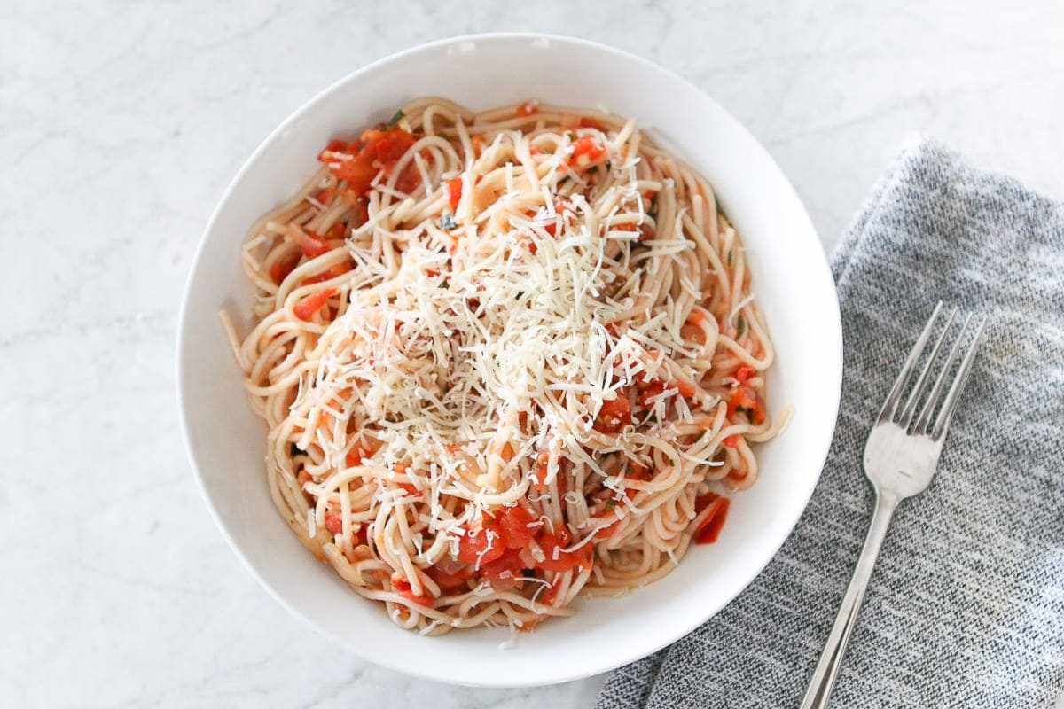 A fresh pasta recipe with grated parmesan cheese on top is the perfect dinner for Valentine's Day.