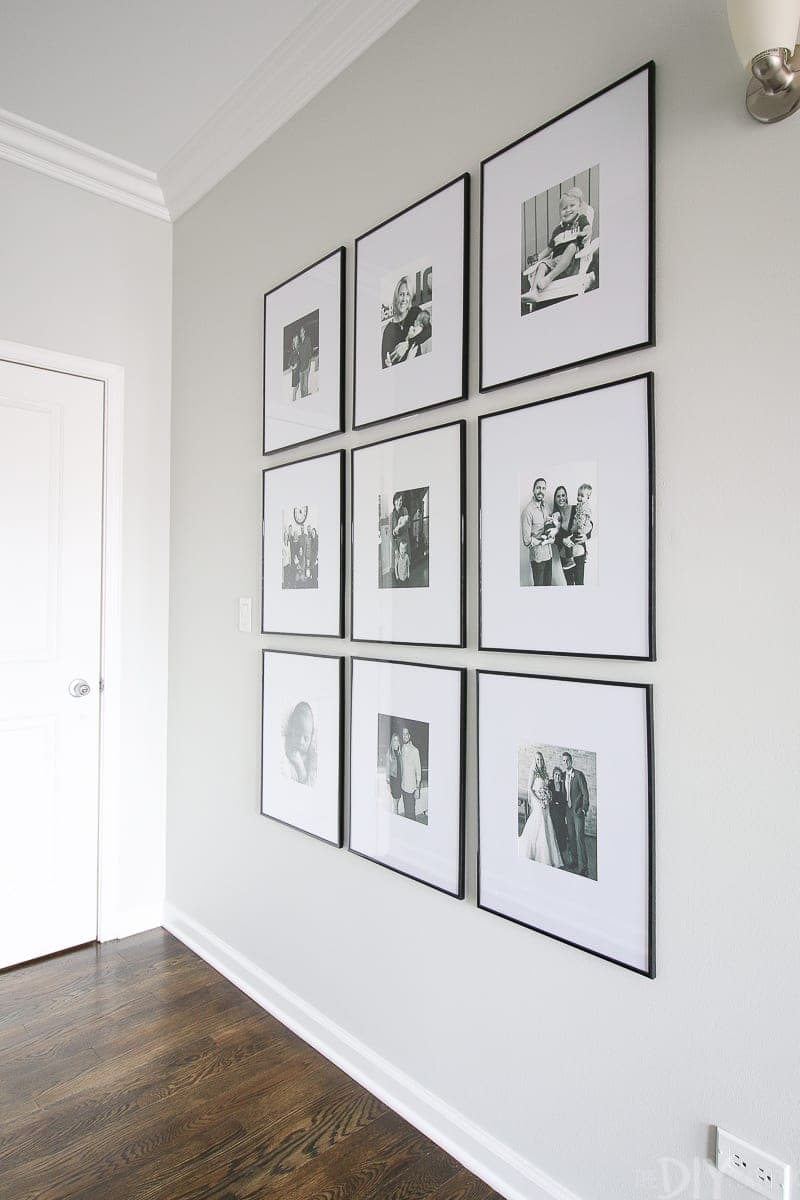 A symmetrical gallery wall in a long hallway