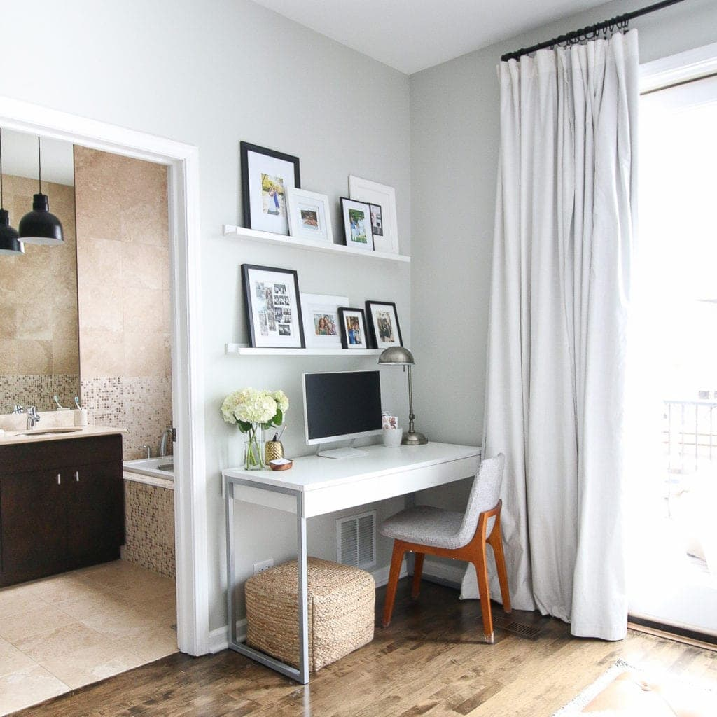 adding a small desk to a master bedroom space