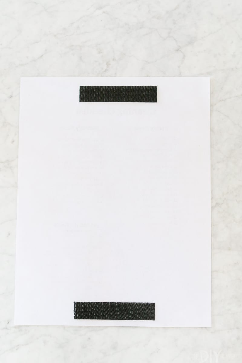 Velcro on the back of a cleaning checklist to hang easily