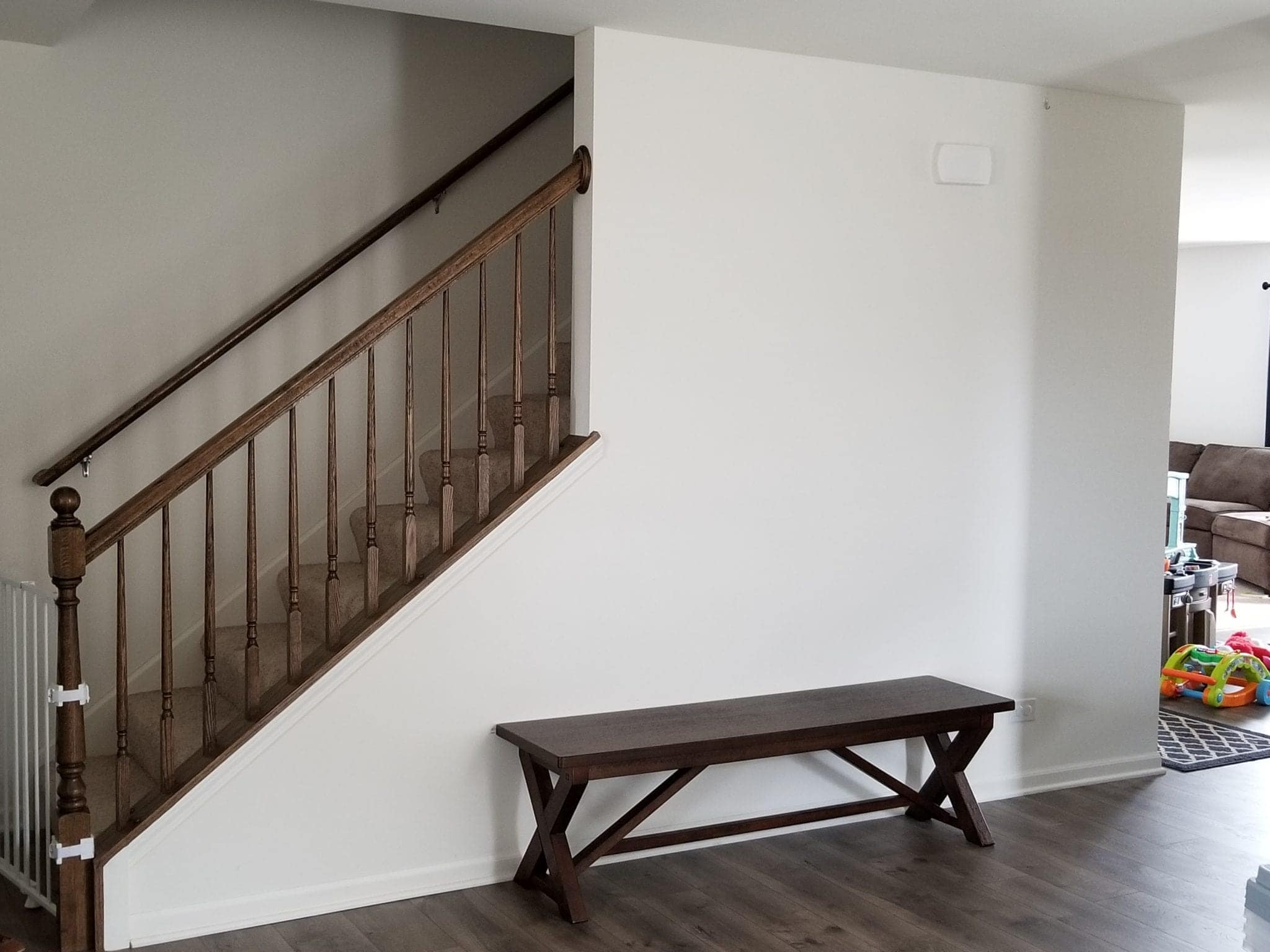 Blank stairwell space could be used as a mudroom