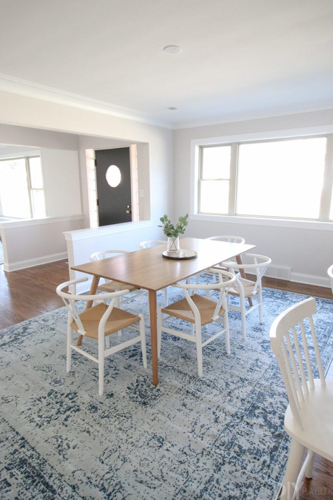 This dining room is still unfinished, but love the blue rug and wood table