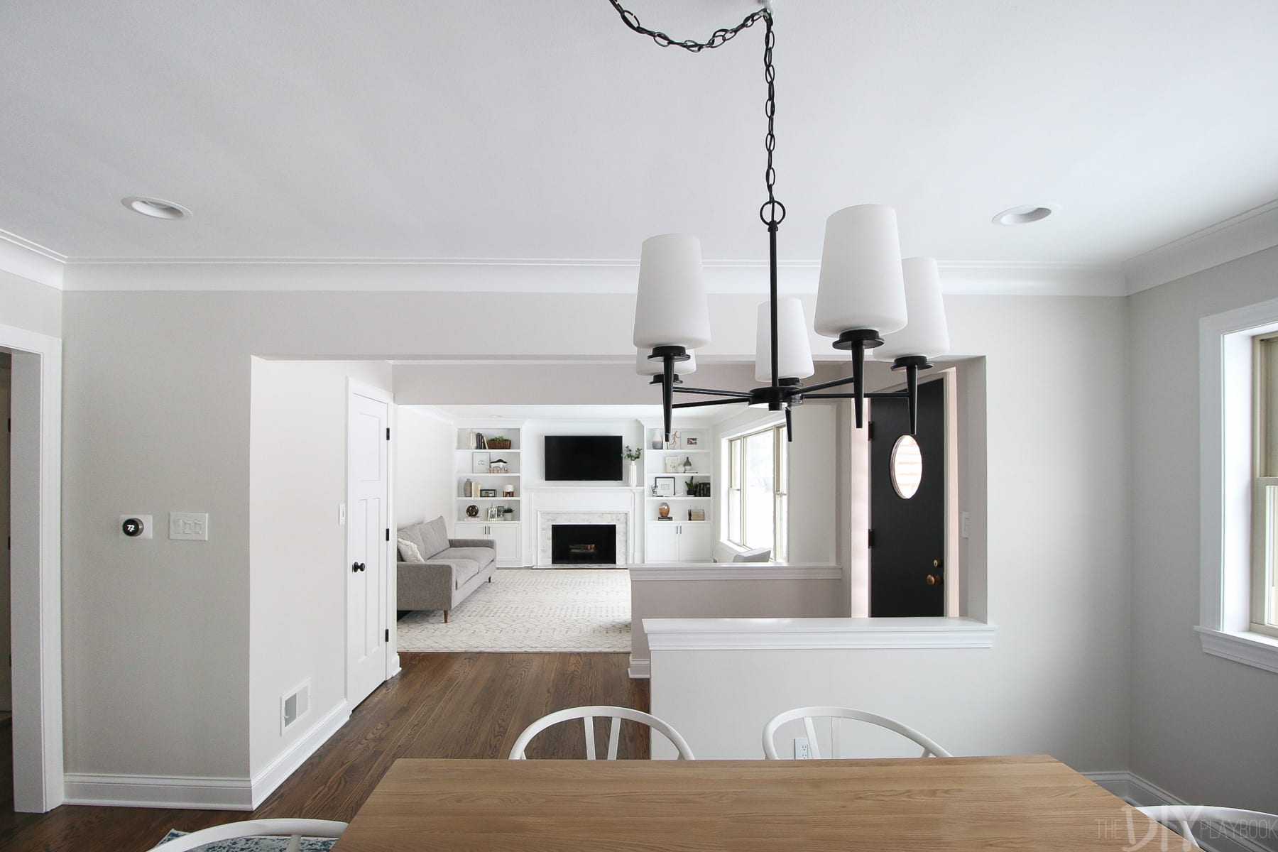 A dining room light fixture in a family room