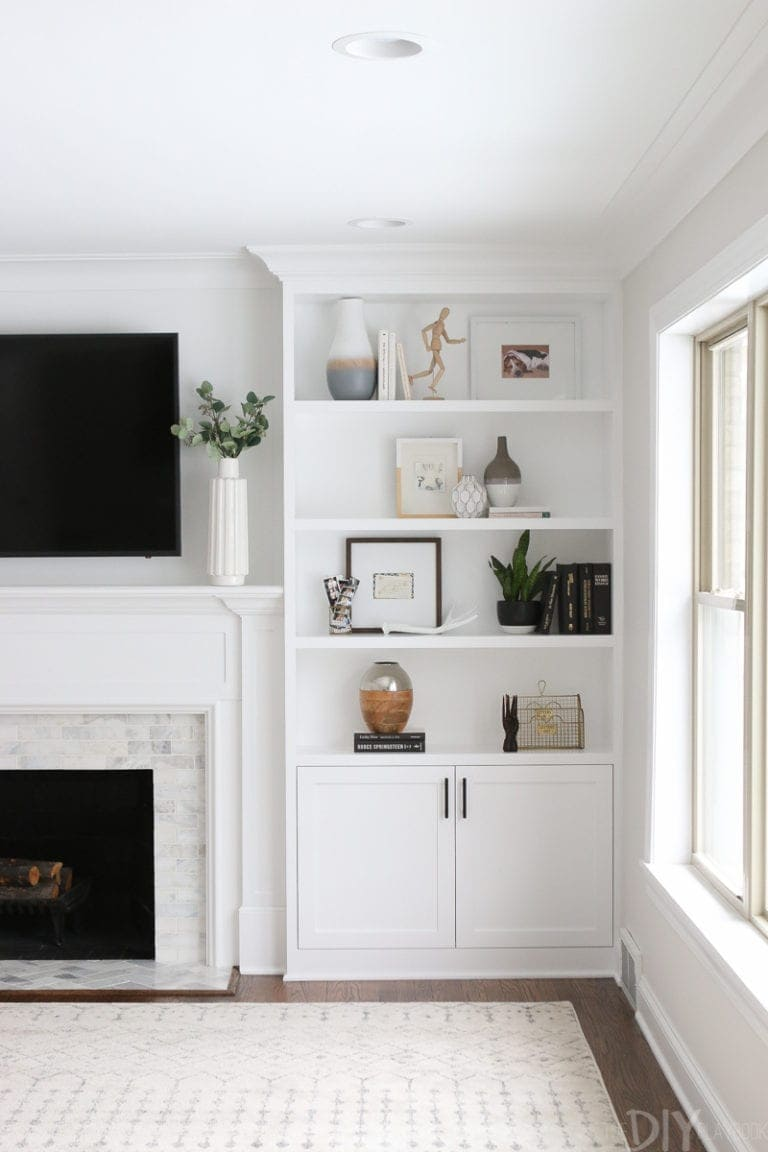 White built-ins around fireplace
