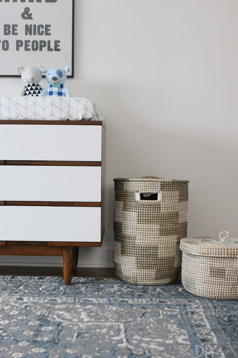 woven baskets add hidden storage in a nursery