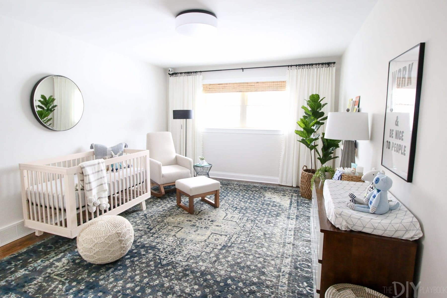 Neutral nursery with a navy rug