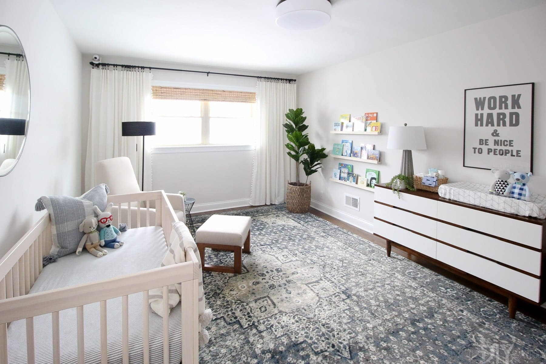 A neutral nursery with dresser, crib, and rocker