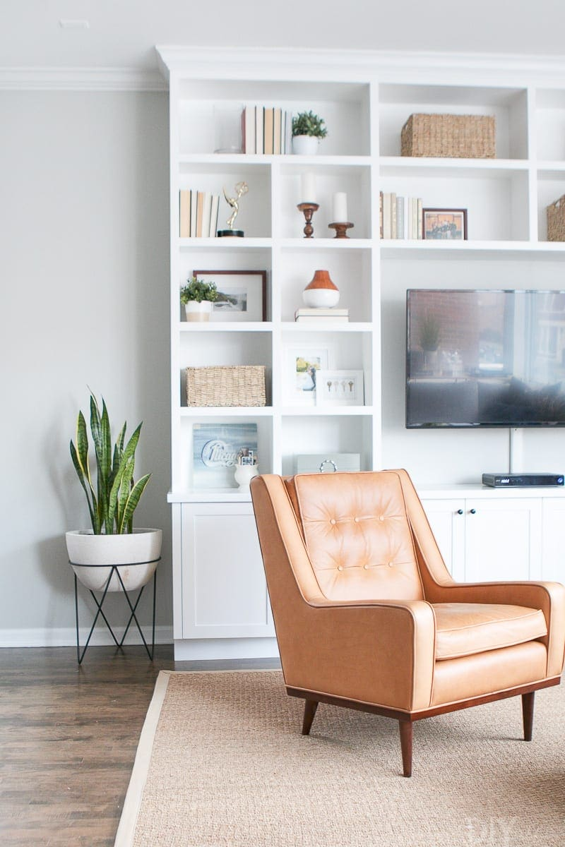 White built-ins with leather chair
