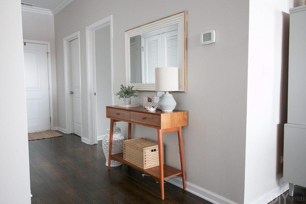 Create a mini entryway in an empty hallway