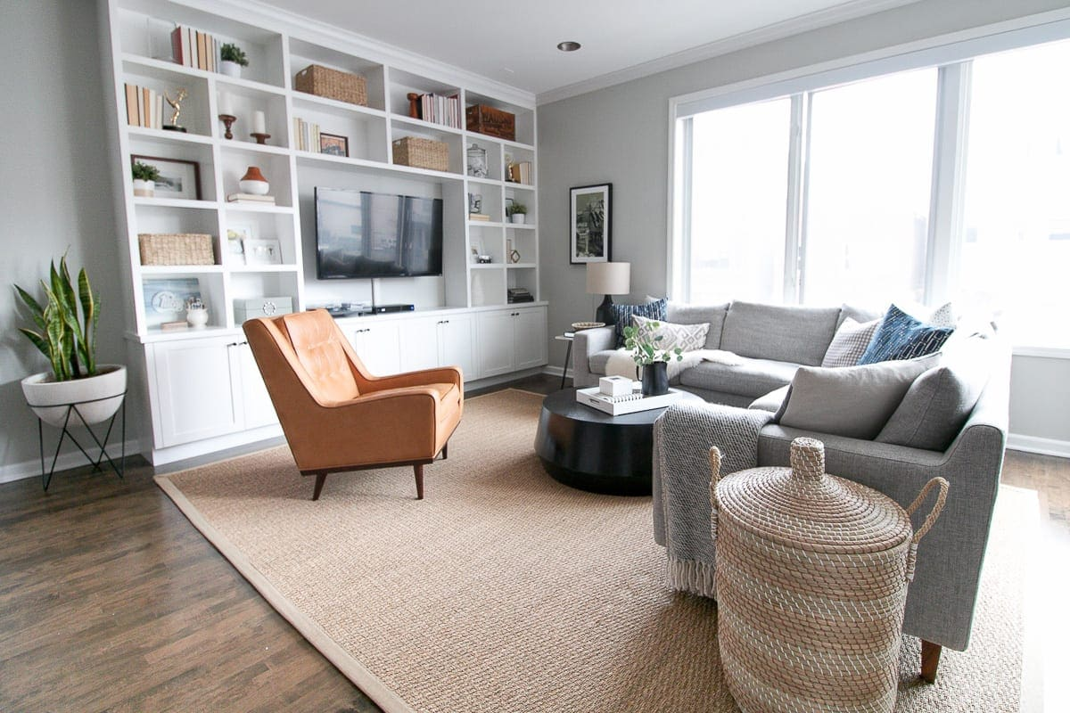 A large seagrass rug works well in a living room space.