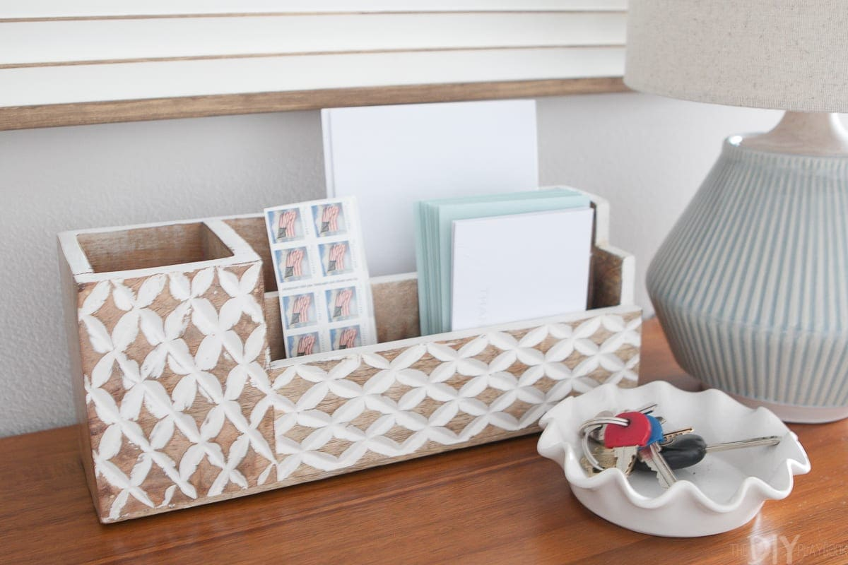 Use a mail sorter and key bowl to corral accessories on your entryway console.