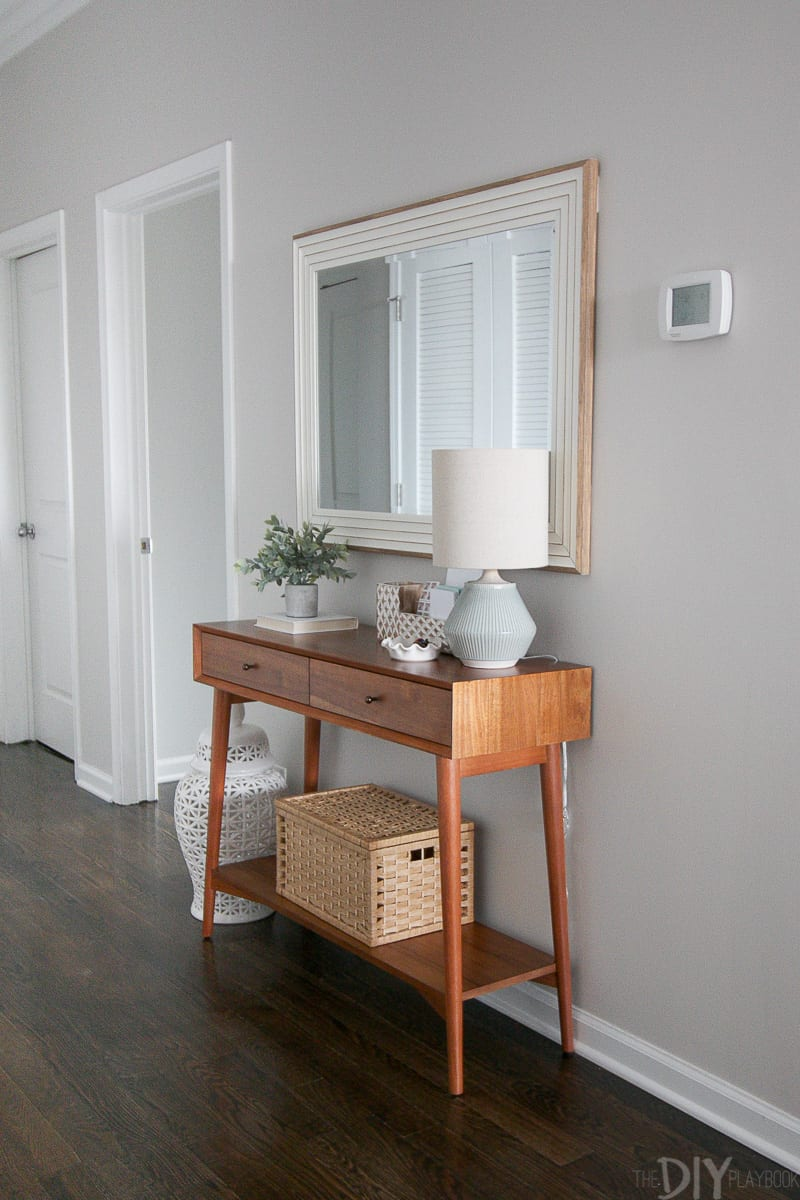 Create a functional entryway space using a slim console, large mirror, and lamp!
