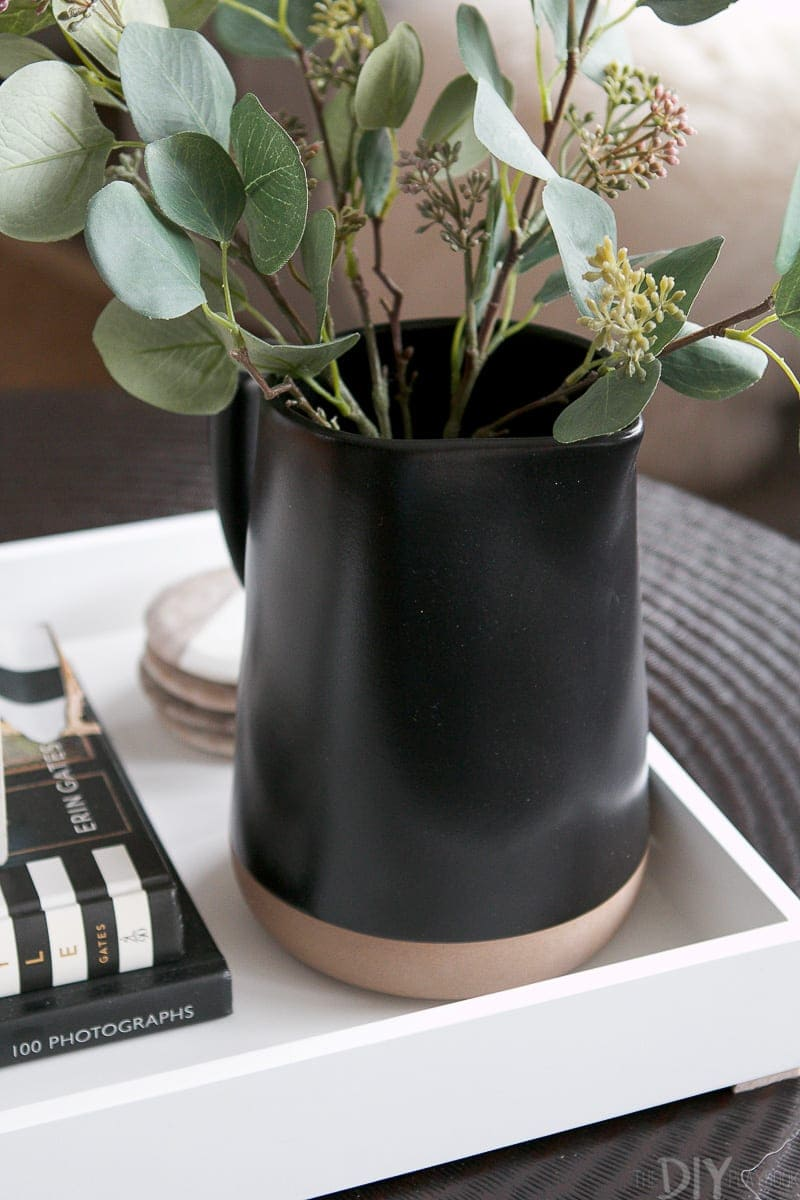 Faux eucalyptus sprigs from Target work perfectly in this black pitcher.