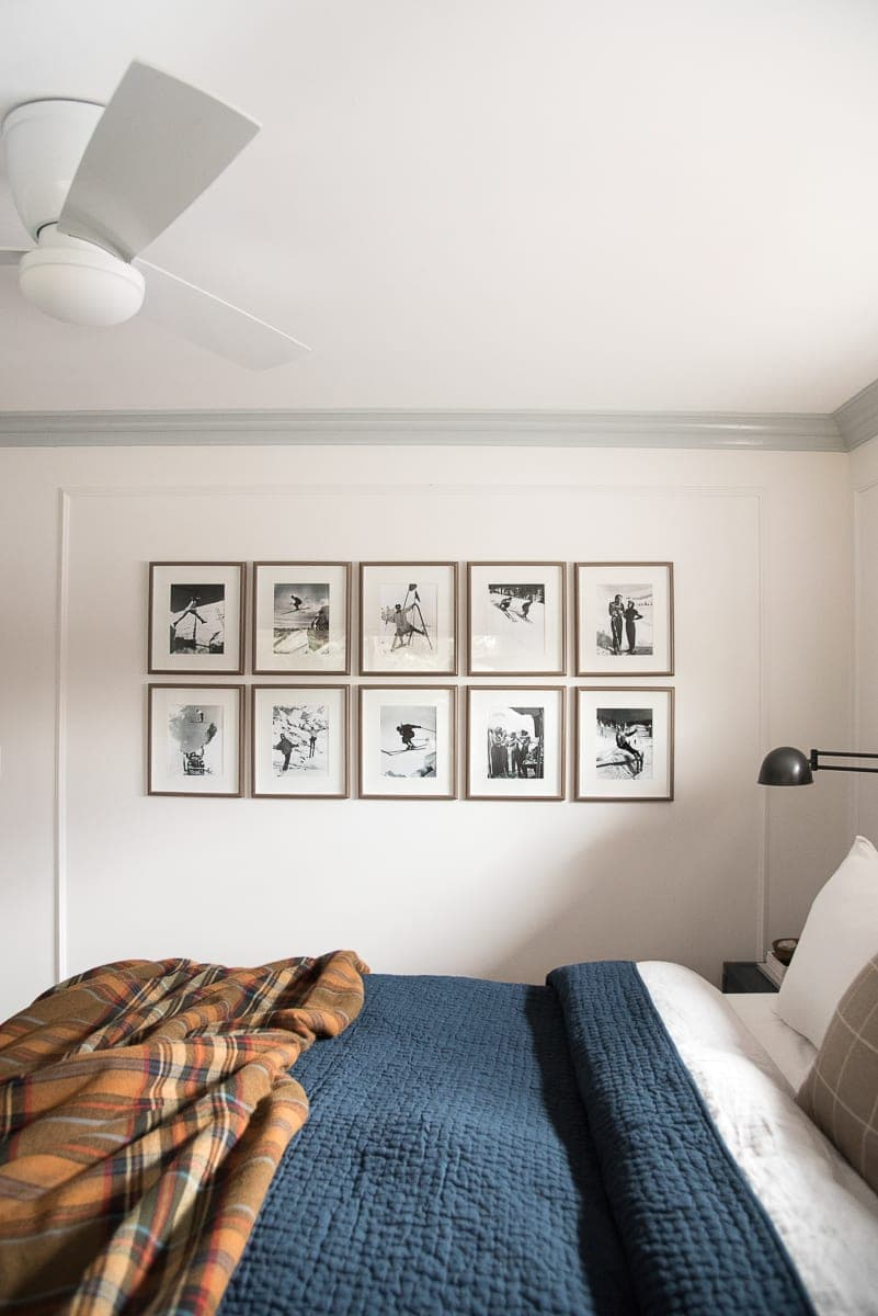 Symmetrical gallery wall hanging in a master bedroom.