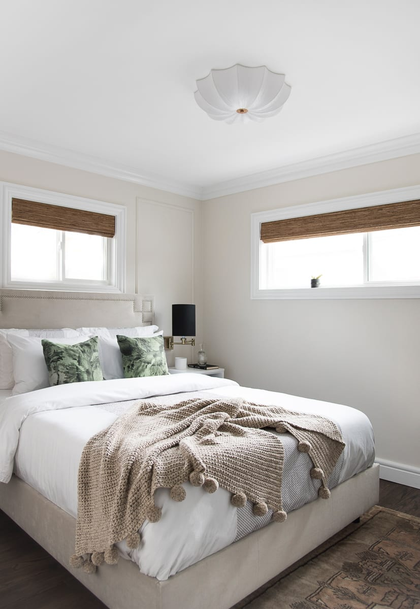 White bedding and neutral bed frame from the blog Room for Tuesday.
