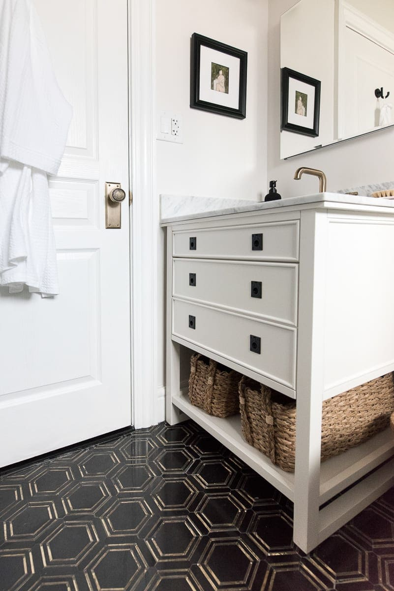 A white vanity with marble top from the blog Room for Tuesday.