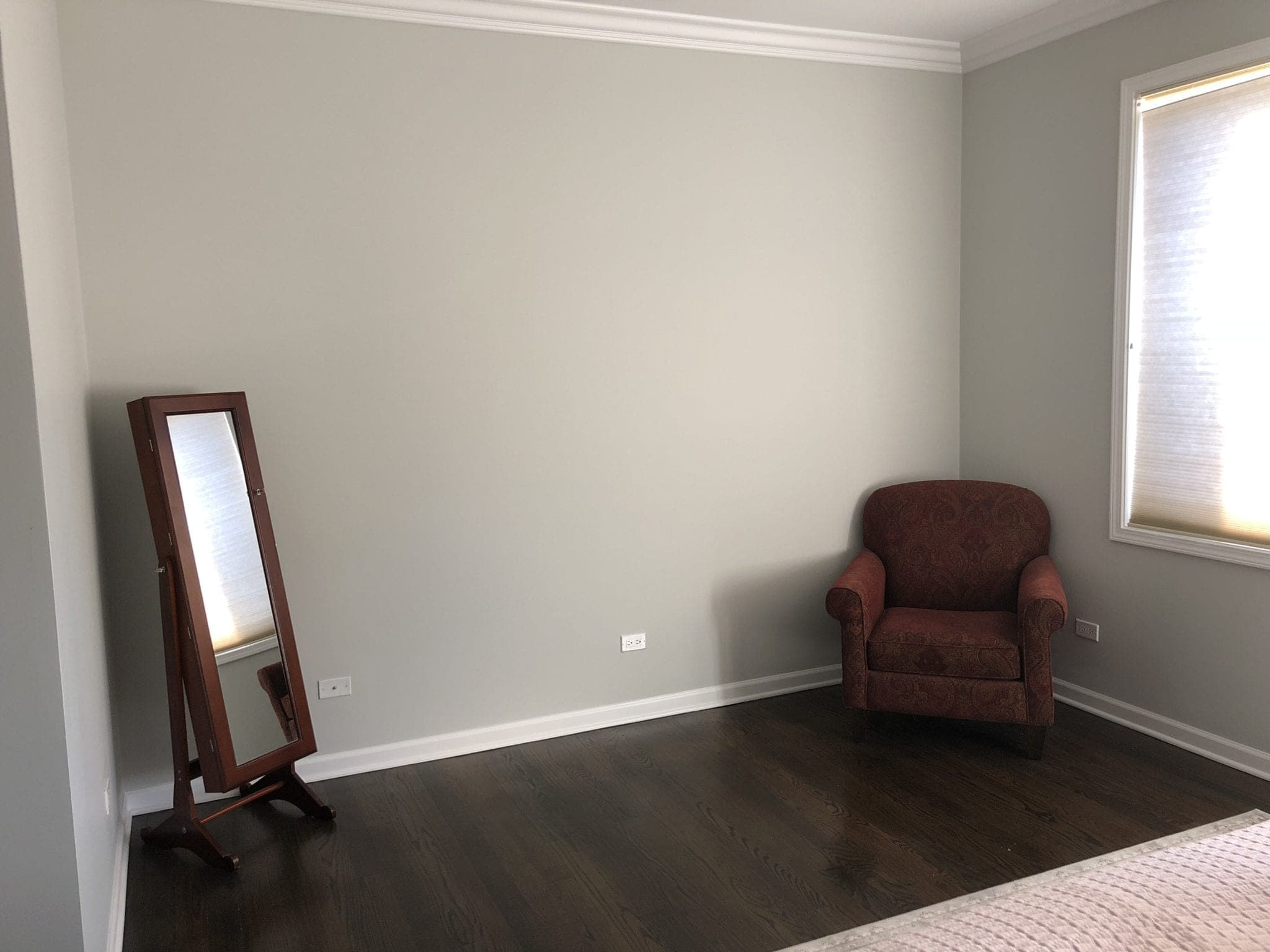 Before photos of a blank wall in a bedroom